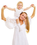 Young mother with daughter on her shoulders Stock Photography