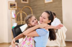 Young mother with a daughter at home Stock Images