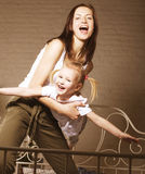 Young mother with daughter at home playing, happy Royalty Free Stock Images