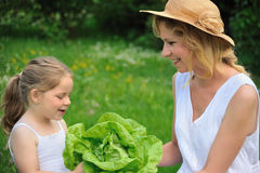 Young mother and daughter with lettuce Royalty Free Stock Photo