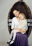 Young mother with daughter at luxury home interior vintage Stock Image