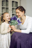 Young mother with daughter at luxury home interior vintage Royalty Free Stock Photo