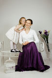 Young mother with daughter at luxury home interior vintage Royalty Free Stock Image