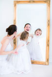 Young mother and daughter at a mirror Stock Image