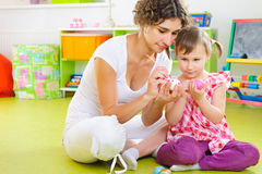Young mother and daughter painting Easter eggs Royalty Free Stock Photography