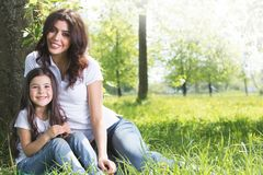 Young mother and daughter in park Stock Images