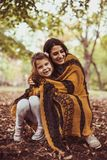 Mother and daughter share love . Happy family. Young mother with daughter in park, share love. Young mother Stock Photography