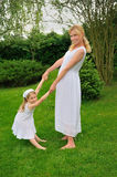 Young mother and daughter playing in meadow Stock Photos