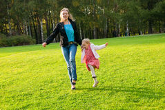Young mother and daughter playing in the park Stock Photography