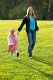Young mother and daughter playing in the park Stock Image