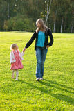 Young mother and daughter playing in the park Stock Photo