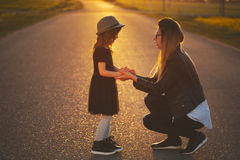 Young mother with daughter on the road Royalty Free Stock Photography