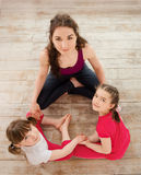Young mother and daughter sitting on the floor Stock Photos