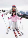 Young Mother And Daughter On Ski Vacation. Smimling at camera happy Royalty Free Stock Photo