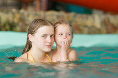 Young mother with daughter swim in aqua park Royalty Free Stock Images