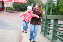 Young mother and daughter walking Royalty Free Stock Photo