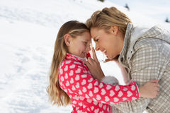 Young Mother And Daughter On Winter Vacation Royalty Free Stock Photography