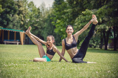 Young mother and daughter working out outdoors Royalty Free Stock Photo