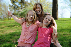 Young Mother and daughters having fun Stock Photo