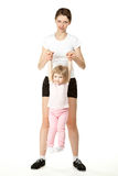 Young mother doing sport with little daughter Royalty Free Stock Images