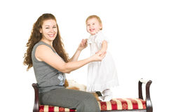 Young mother and doughther on sofa Royalty Free Stock Photo