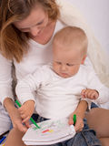 Young mother is drawing with her son Stock Photography