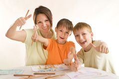 Young mother draws with his sons Royalty Free Stock Photography
