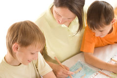 Young mother draws with his sons Stock Photo