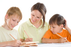 Young mother draws with his sons Royalty Free Stock Photo