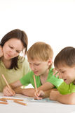 Young mother draws with his sons Stock Images