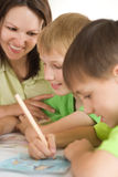 Young mother draws with his sons Royalty Free Stock Photos