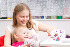 Young Mother Drink Tea With Adorable Daughter Stock Images