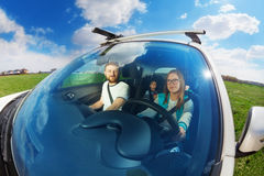 Young mother driving car with her family Royalty Free Stock Photo