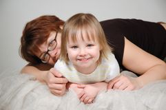 Young mother embraces the young daughter and smile Stock Image