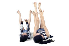 Young mother exercising with her daughter Royalty Free Stock Images
