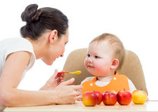Young mother feeding baby stock images