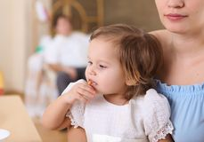 Young mother feeding her baby royalty free stock photography