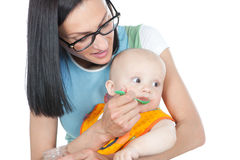 Young mother feeding her baby Stock Image