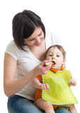 Young mother feeding her baby Stock Images