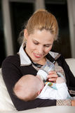 Young mother feeding her child Royalty Free Stock Photo