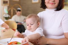 A young mother feeding her infant baby Stock Photography