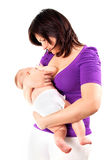 Young mother feeding her little baby with breast Stock Image