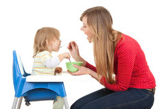 Young mother feeding hungry baby Royalty Free Stock Images