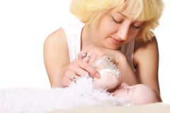 Young mother feeds her baby Royalty Free Stock Photos