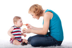 Young mother feeds  her baby. Stock Image