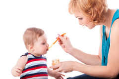 Young mother feeds  her baby. Royalty Free Stock Photo