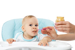 Young mother feeds  her baby. Stock Photography