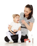 Young mother feeds  her baby. Stock Photo