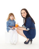 Young mother feeds  her child. Royalty Free Stock Images