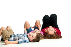 Young mother on the floor with her children Royalty Free Stock Photography